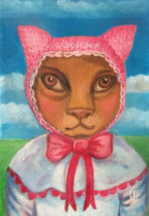 an oil painting and print of a brown cat in a pink knitted hat and white dress with pink bow.  Blue sky, green grass.  Brown Cat Eyes.