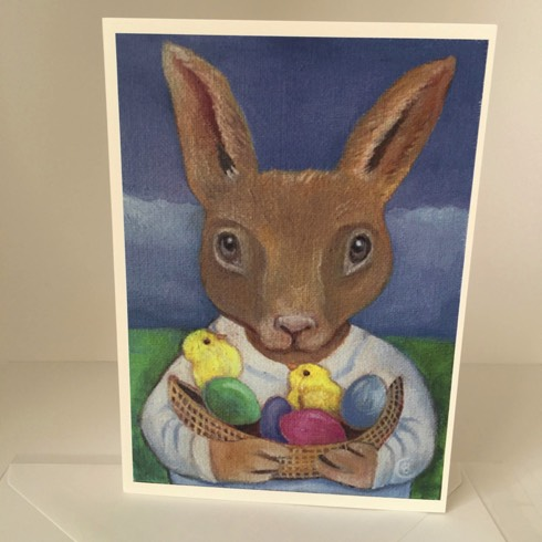 a rabbit holding a basket of eggs and chicks greeting card